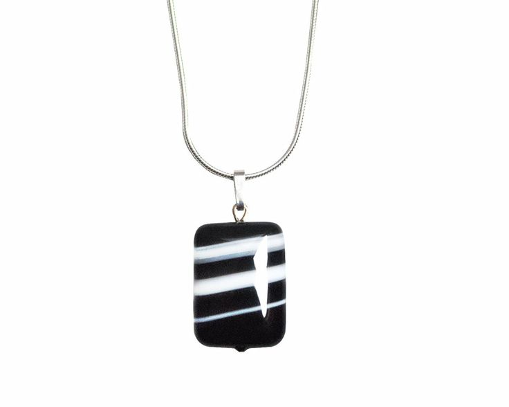 Black striped agate pendant is supported by a Sterling Silver 925% serpentine chain with a lobster clasp closure. The necklace has a modern and special look due to rectangular shape of the black agate with white inclusions. The semi-precious stone measure 20x15mm, the serpentine chain 45cm.