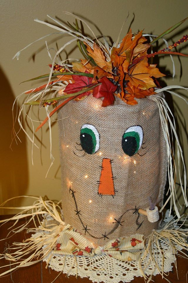 My favorite!  Scarecrow burlap bag with lights.  Love the corn cob pipe!