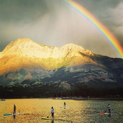 This is why an evening paddle is usually the best... Calm water, sunset, and rainbows. My phone missed the double rainbow. #liveinsidethepostcard #waterton @travelalberta #imagesofcanada #experiencewaterton #travelcanada #sup #standuppaddle #rockymountains #vimmyridge #blakistonandco