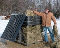 bob filling horse hay feeder