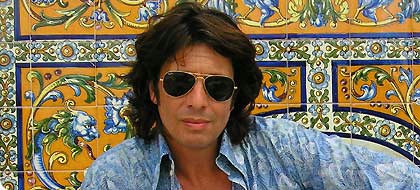 Laurence Llewelyn Bowen.  The extraordinarily good looking designer from the UK series Changing Rooms.