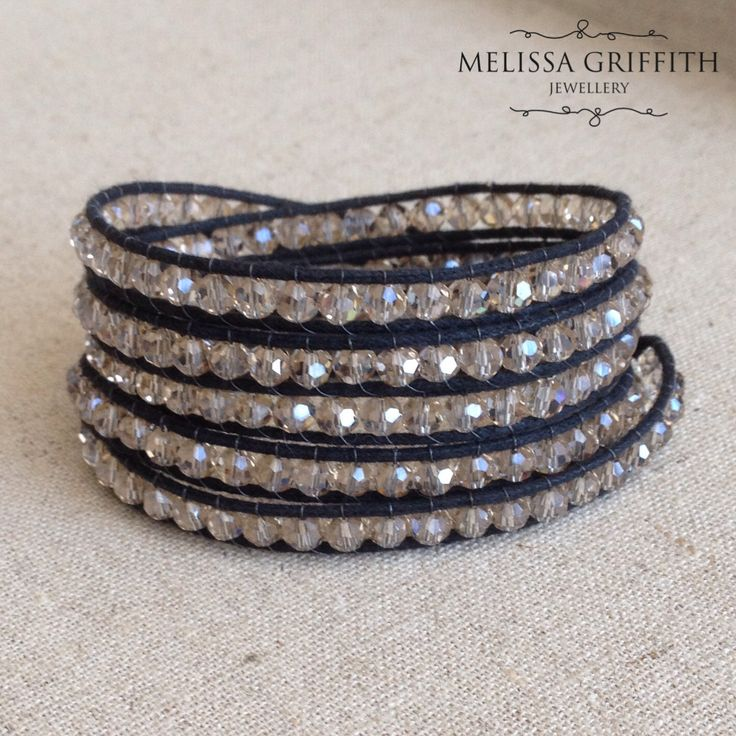 Champagne Crystal 5 Wrap Bracelet (MGB84) $45.00  This wrap bracelet features 4mm round faceted champagne crystals stitched to black waxed cotton cord with strong nylon beading thread. The ends are finished with a silver tone metal button and two loops for adjustment. Designed to wrap a 6-7 inch wrist 5 times or a 7.5-8.5 inch wrist 4 times. Adjustment loops can be trimmed with sharp scissors for a custom fit.