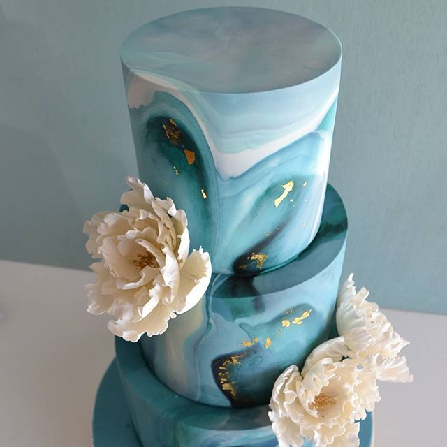 3 tier round wedding cake washed in paua colour.