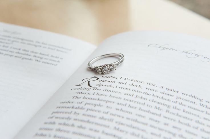 three-stone engagement ring literary wedding