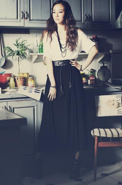 For a smart casual look, pair that maxi skirt with a button blouse