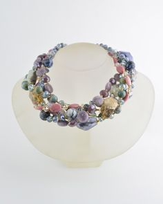 MULSTI STRAND TWIST PASTEL from Barrera.  Necklace is made of a mixture of semi precious beads in tones of pastel and faceted glass beads. Pastel dyed rock crystal, fire agates, pink rhodochrosite, and  pale green jasper.  Necklace measures 16.5 inches long with a 3 inch 24 karat gold plated chain extender.