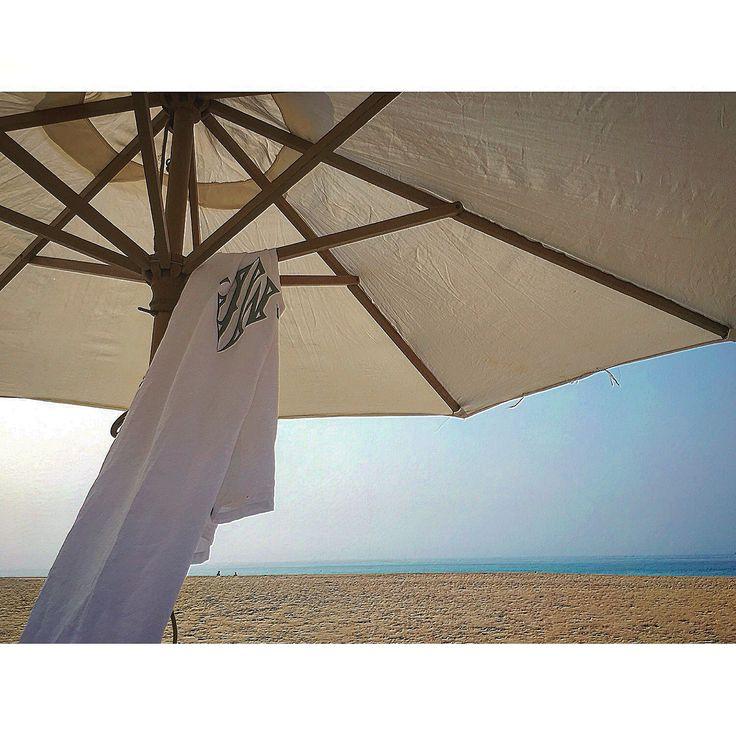 MarinaC - monogrammed sarong on an exotic beach
