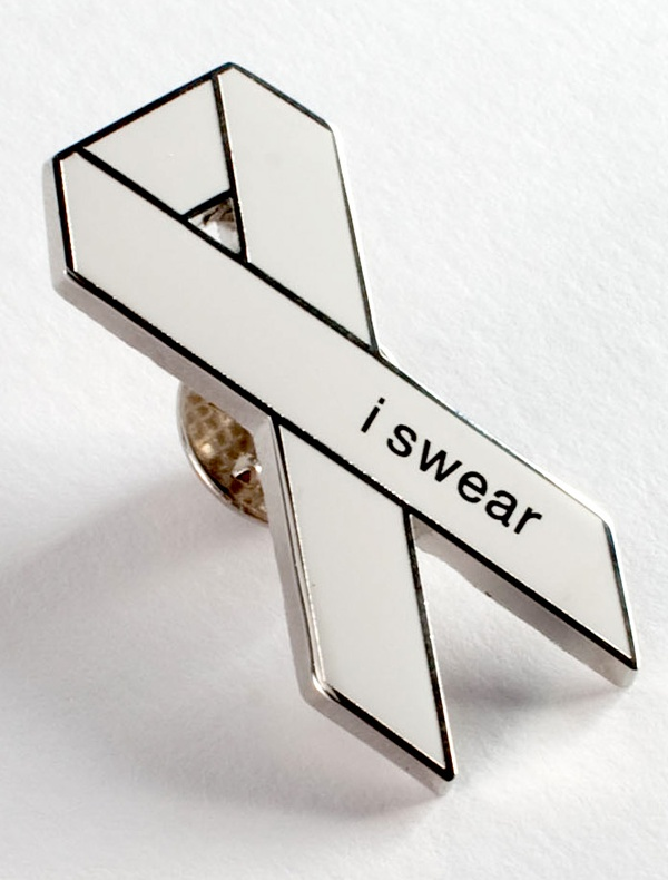 "Custom designed White Ribbon Lapel Pin in enamel, with shiny nickel finish and ""i swear"" printed text. Available from White Ribbon Australia. Or individually from various stockists Australia-wide."