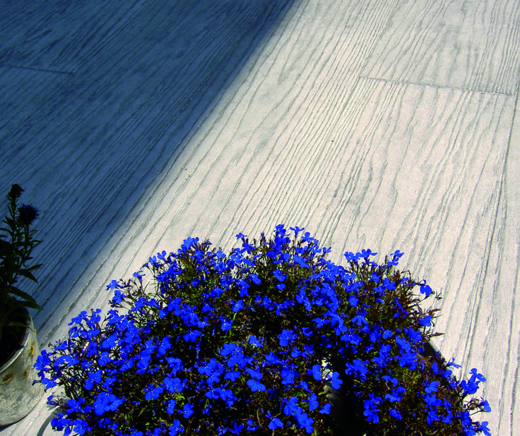 stylish colors - grey stamped #concrete floor, wood effect http://www.idealwork.com/Stamped-concrete-Features-and-benefits.html