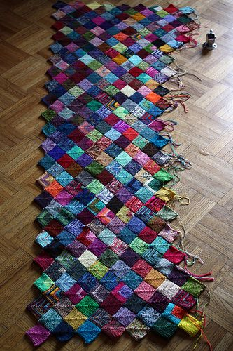 Lots and lots of little mitered squares!  A good way to use up left over yarn.
