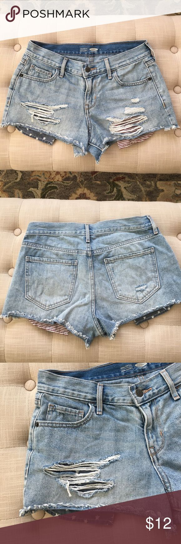 Old Navy American Flag Destroyed Jean Shorts  Old Navy American Flag Destroyed Jean Shorts, worn only one time for the 4th of July, Size 2, One Pocket is blue with white stripes the other is red with white stripes. Old Navy Shorts Jean Shorts