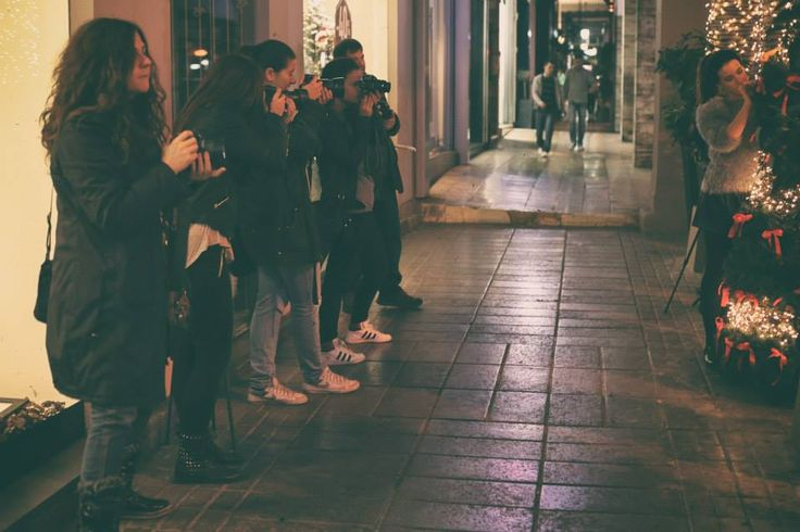 Night photo shoot in festively lighted city street
