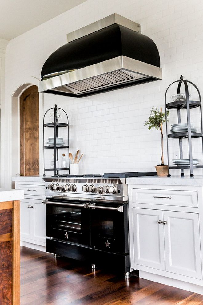 Kitchen with counter to ceiling backsplash tile, 5 star range and black hood. Kitchen with counter to ceiling backsplash tile, 5 star range and black hood. #Kitchen #countertoceilingbacksplashtile #backsplashtile #5starrange #blackhood Hyrum McKay Bates Design, Inc.