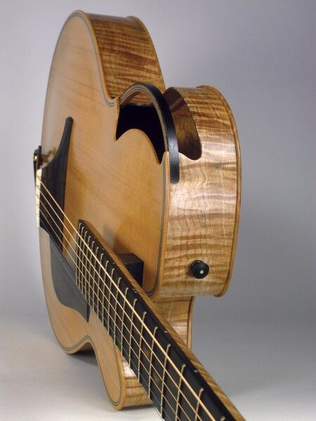 Guitar maker Luthier Ken Parker created this fascinating stringed instrument with a very different place for the sound hole. Lovely wood grain, almost like koa wood on the sides. MOST POPULAR RE-PINS - RESEARCH #DdO:) - http://www.pinterest.com/DianaDeeOsborne/instruments-for-joy/ -  He began building guitars + basses, first for his brother. Became 1 of best-known guitar luthiers in the industry. Clients incl Pete Townshend of The Who, Paul Simon, Lou Reed, Joni Mitchell.