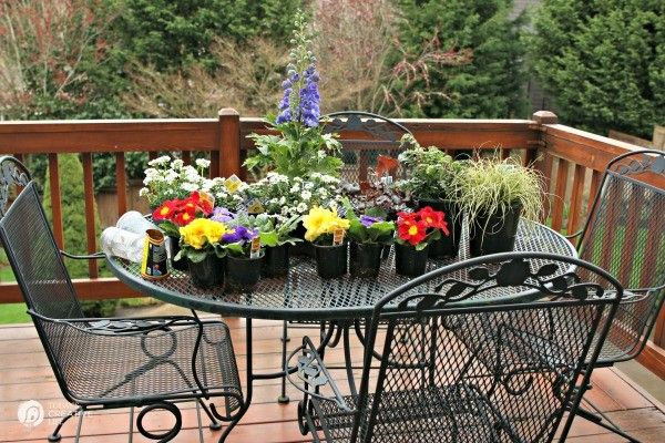 Springtime Decorating Ideas| Spruce up your patio with these ideas. This is how we do it in the wet spring months in the PNW. Click the photo to see more. TodaysCreativeLife.com