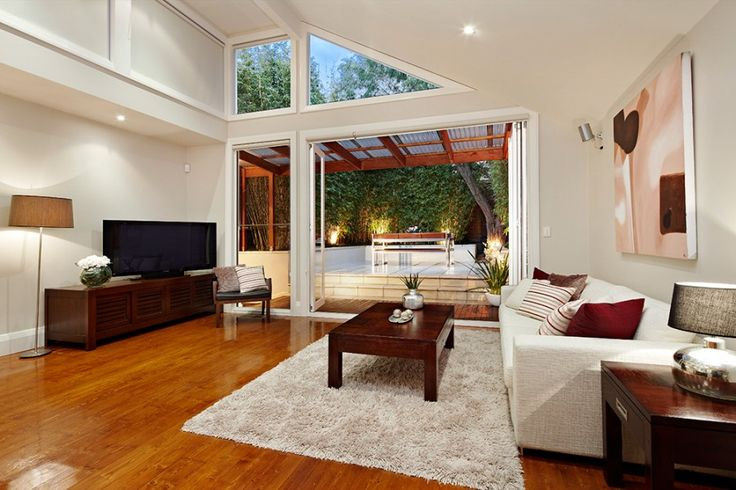 Living room meets outdoors. Very modern living room with very elegant floor carpets and lounge.