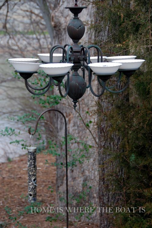 repurposed chandelier as a bird feeder, but could also have deeper dishes and put hanging plants in it or covered bird feeders using mason jars. Could also be a bird bath (cleaned daily to avoid mosquito breeding)?