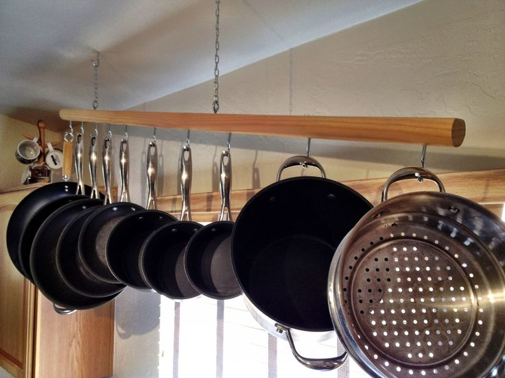 Less is more, this chic modern pot rack is unimposing, convenient, and elegant looking. You can adjust the hook positions, the angle, and the chain to fit any ceiling and pot and pan set. It comes pre-assembled but you can adjust it.  Hang your pots and pans above your sink to dry and de-clutter your cupboards. The rack has a clean sturdy design built to support any standard cooking set. After looking at how expensive and garish other pot racks are, I hand crafted this for my wife and a few…