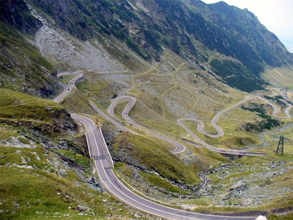Transfagarasan Road — Romania.  Wow. Oh please sir may I with a very fast car and the road closed!