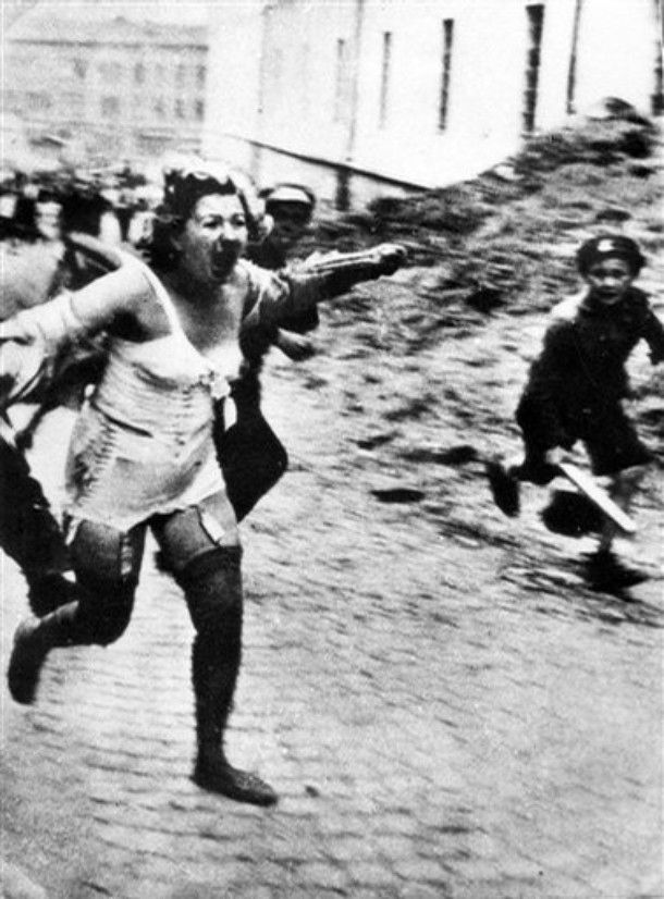 Young Ukranian Teenagers throw stones at Jewish Woman • The Lvov Pogrom of 1941 in Ukraine