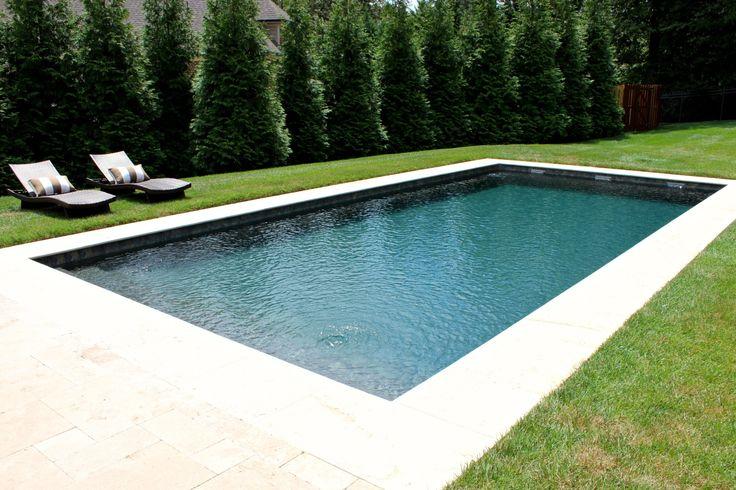 Simple rectangular fiberglass pool with sheer descents.
