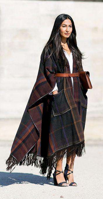 A tartan blanket poncho