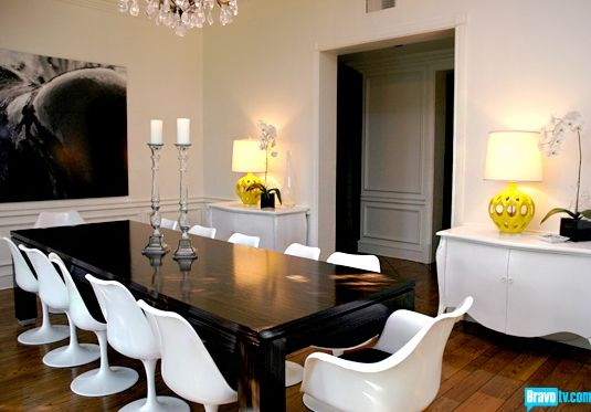 Rachel Zoe's Dining room. That pop of neon yellow on those nifty lamps MAKES that room complete.