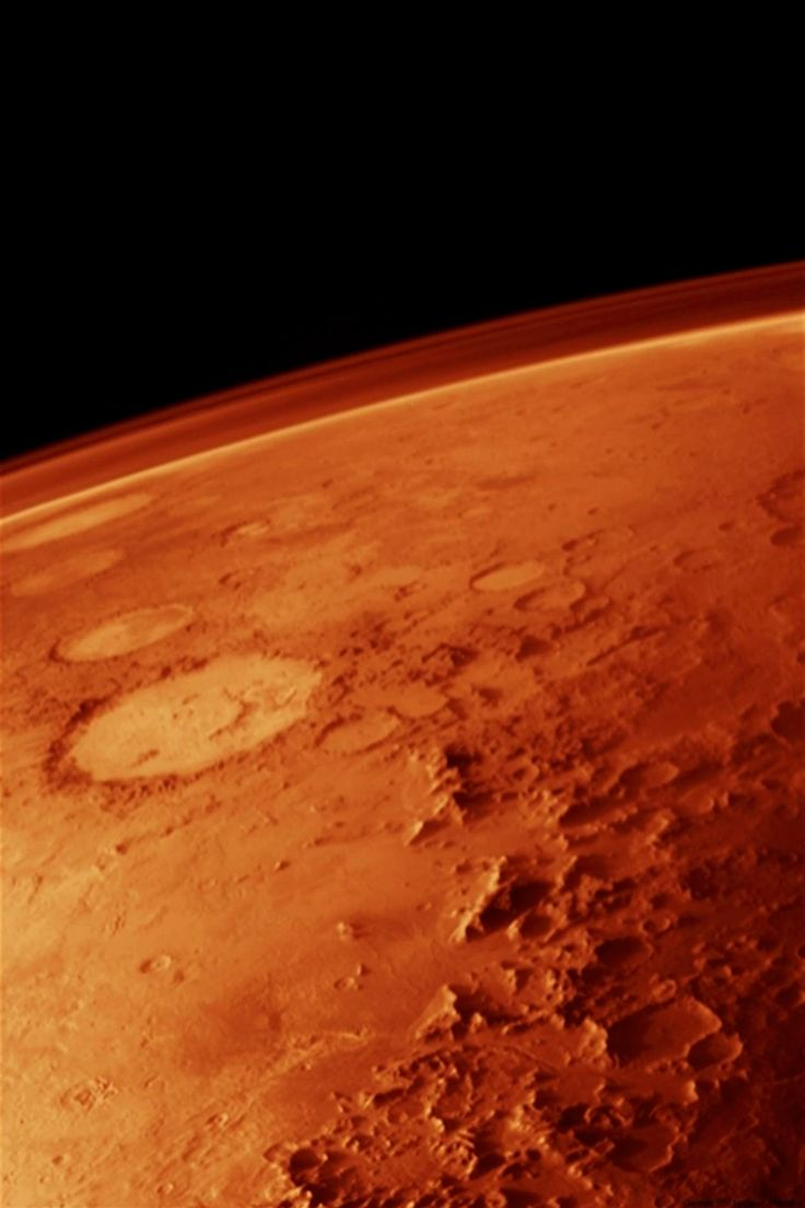 """The Atmosphere of Mars taken from low orbit. The Galle """"smiley"""" crater can be seen to the left. Viking Orbiter, 1976"""