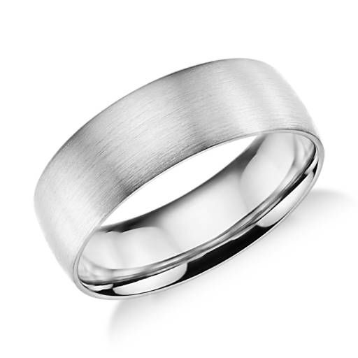 This platinum wedding ring features a traditional higher dome profile, modern brushed finish and a rounded interior for comfortable everyday wear.