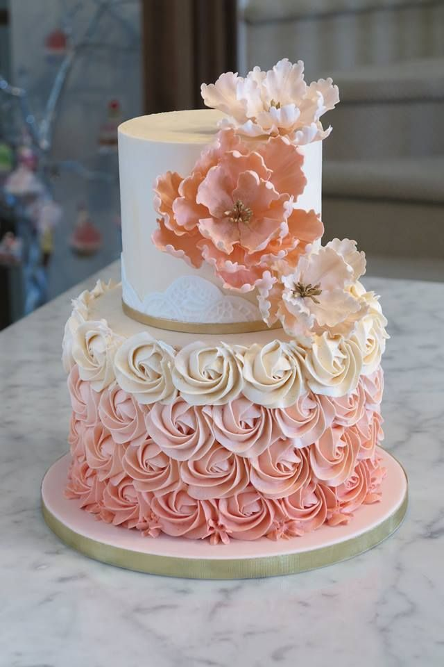 Buttercream Rose swirl cake with gold accents and handmade sugar flowers!