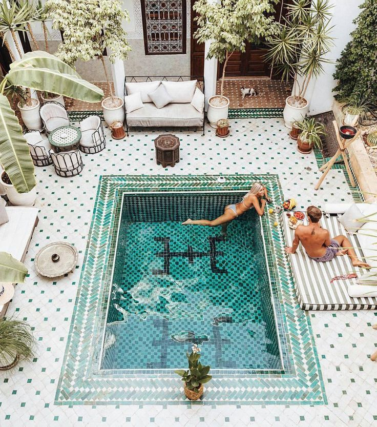 White tiled courtyard pool - Love the tones and patterns!