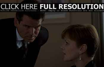 Miss Moneypenny - Pierce Brosnan and Samantha Bond in MGM's The World Is Not Enough - 11/99