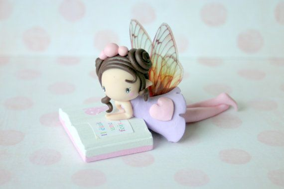 Fairy figurine with book by TheDollAndThePea on Etsy