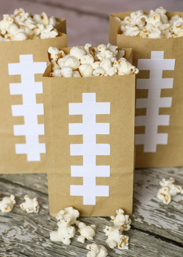 Make cute and simple Football Bags to hold your Homemade Butter Popcorn. They are easy to re-fill and can be used all Super Bowl Sunday long which limits the mess and cuts down the use of more paper goods.