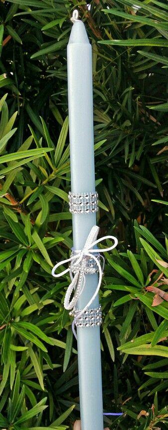 Light blue easter candle with shambala cross bracelet $ 35