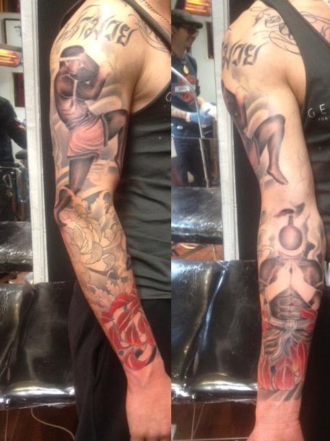 A badass muay thai tattoo sleeve
