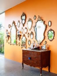 wall of mirrors decorating idea - around big mirror in dining room... Will Do something similer someday