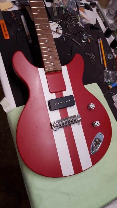 """Another cool creative build. It's actually  a 3/4"""" plywood frame with a 1/4"""" plywood top and back. The glued in neck is also plywood with a walnut fingerboard. At around 5lbs it's so light you can play it all night. I call them Plyluxe guitars. For sale now and more coming soon."""