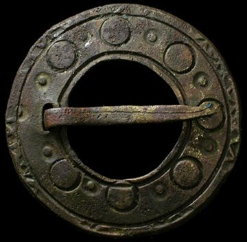 "This is actually much more recent than Viking. 15th-17th c. I  believe. ""Huge Viking bronze brooch, c. 8th-9th century AD. Comprised of a large, flat disc with notch and pin. Round incised details around the front surface. Great copper-green patina. Big 43 mm (1 5/8"") diameter. Found in Latvia"""