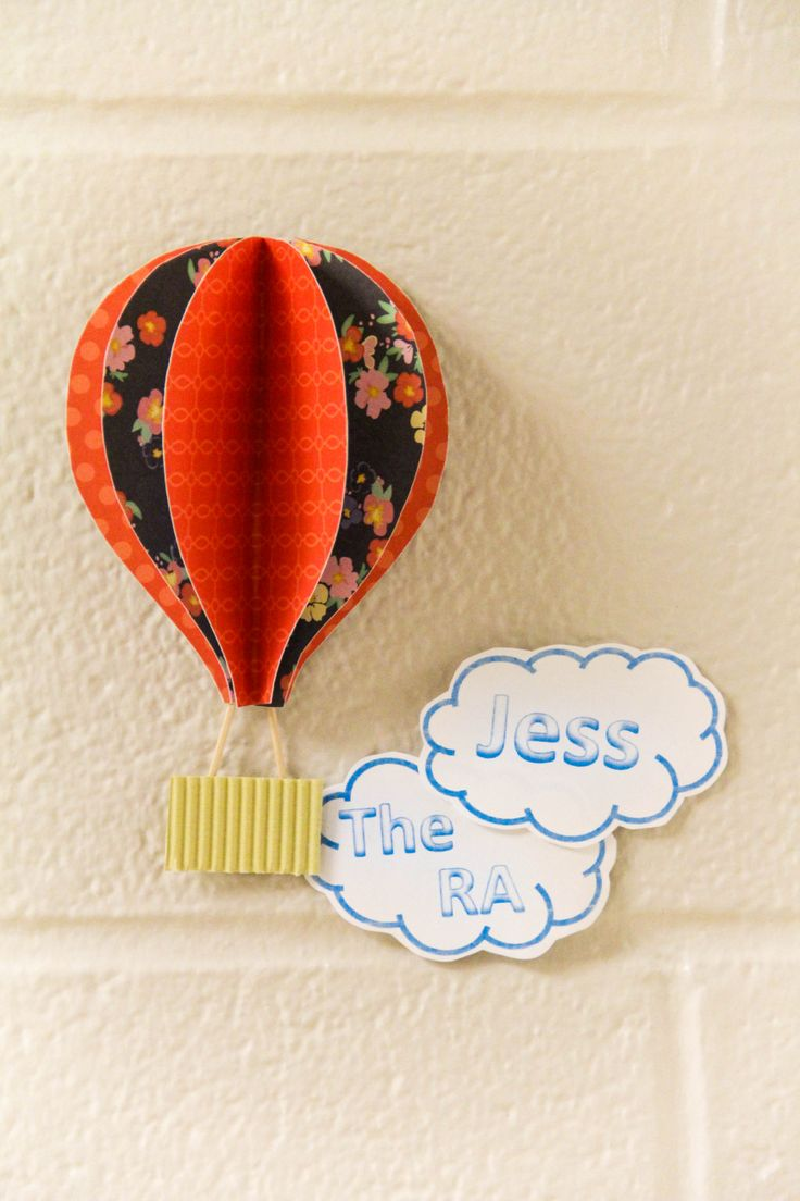 Hot air balloon door decs! Take three pieces of paper that are the same hot air balloon shape, fold them, and hot glue them together! I used tooth pics to connect the balloon to the basket. resident advisor / resident assistant / RA