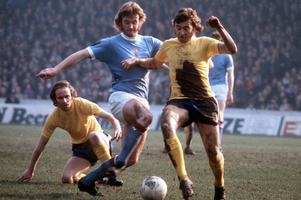 27th March 1973. Chelsea's Alan Hudson is tackled by that other seventies maverick, Manchester City's Rodney Marsh.