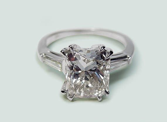 #DN18 - White Gold 14K - There is one radiant diamond in center of approx. 3.00 carats & two baguette diamonds approx. 0.20 carats each on side Earth mined diamonds. - Total Stone Weight : approx. 3.40 carats - Color : G - Clarity : VS2/VVS1 - Retail Appraised Value : $49500.00