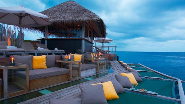 Love this deck and lounge concept from Soneva Fushi, in the Maldives | Would be great to use canvas sails as both shade providing awnings and as a hammock type loft by building this above a deck or patio on a pergola structure and adding a wooden ladder.