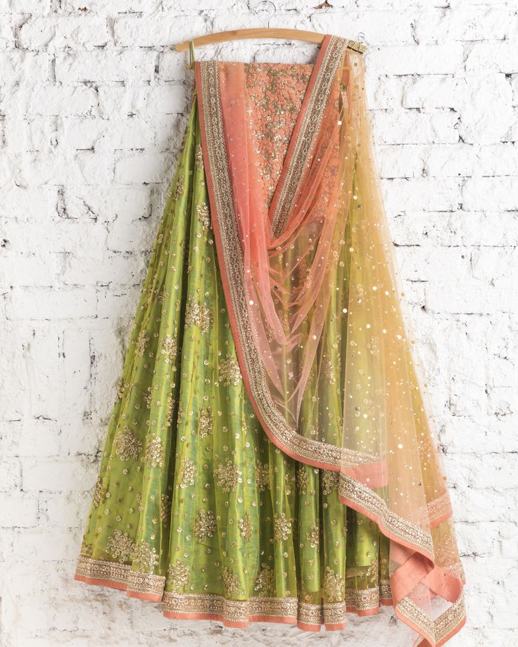 Lehengas by SwatiManish : Mehendi green lehenga and peach dupatta
