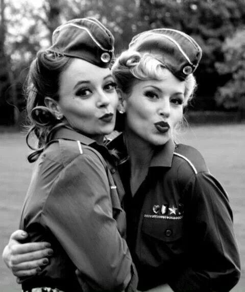 World war 2 - the women still had it! They wore army clothes, had their hair curved perfectly, red lips and posed with the duck face! And how cute their hats are!