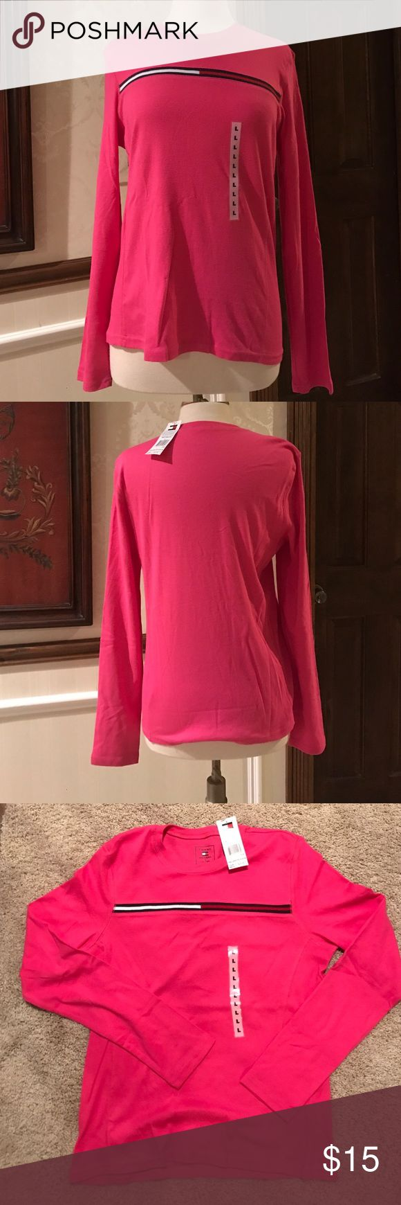 Tommy Hilfiger Pink Long Sleeved T-Shirt Tommy Hilfiger Pink long sleeved athletic style loose t-shirt. The item is brand new with tags and has the signature Tommy Hilfiger logo knitted into the design of the shirt. There is a ribbed section on either side of the shirt apart from that the shirt is plain. 100 % cotton. US size L. Tommy Hilfiger Tops Tees - Long Sleeve
