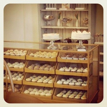 Love these old haberdashery units used as cake display