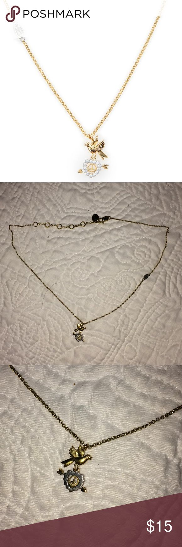Juicy Couture peace bird necklace Adorable two toned necklace  Condition; EUC, no sign of wear. Clasp is in good functional condition Reasonable offers welcome! Juicy Couture Jewelry Necklaces