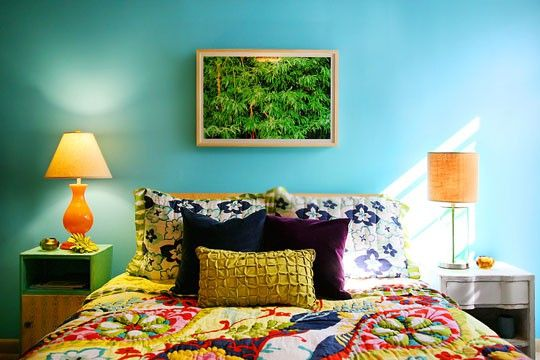 Turquoise blue bedroom with multicolour bedding....I like that it isn't matchy matchy....