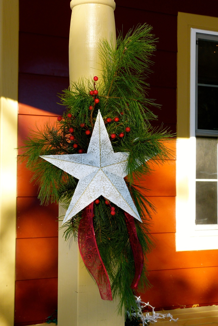 Christmas boughs with berries and white star.